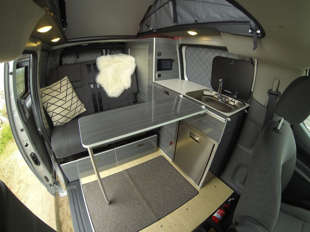Interior of a Recon Campers custom Nissan NV200 camper van conversion