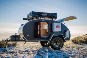 escapod with teardrop camper accessories on the back