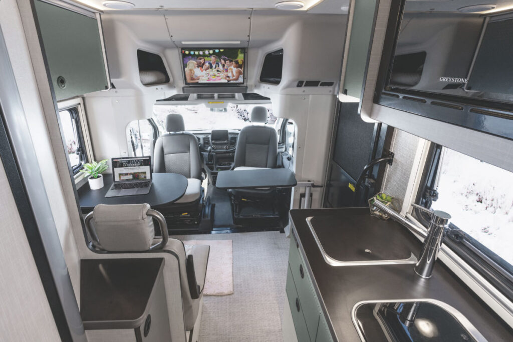 The Winnebago Ekko's interior with a table and kitchen