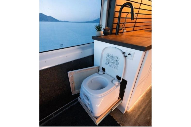 Toilet that hides in cabinet compartment