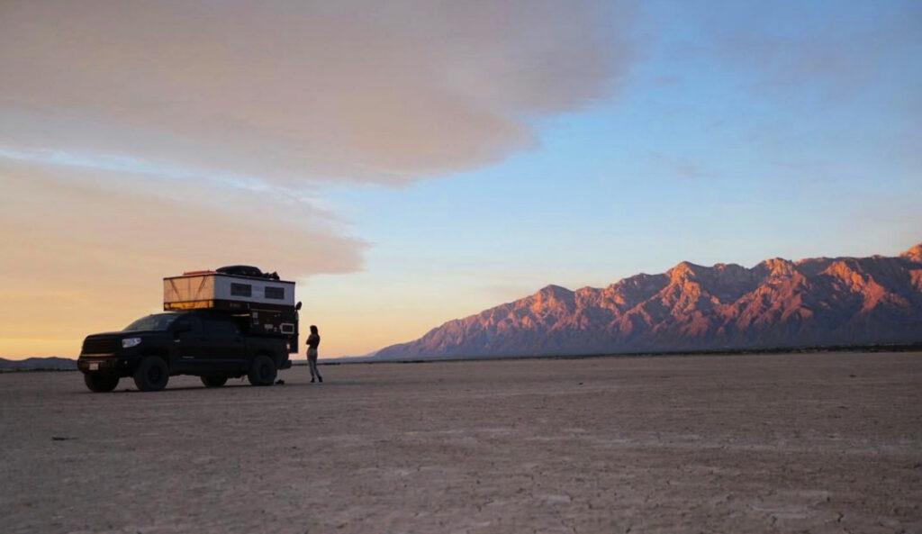 truck camper parked in the baja desert