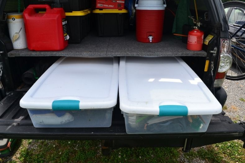 Under bed storage boxes installed in truck camper shell