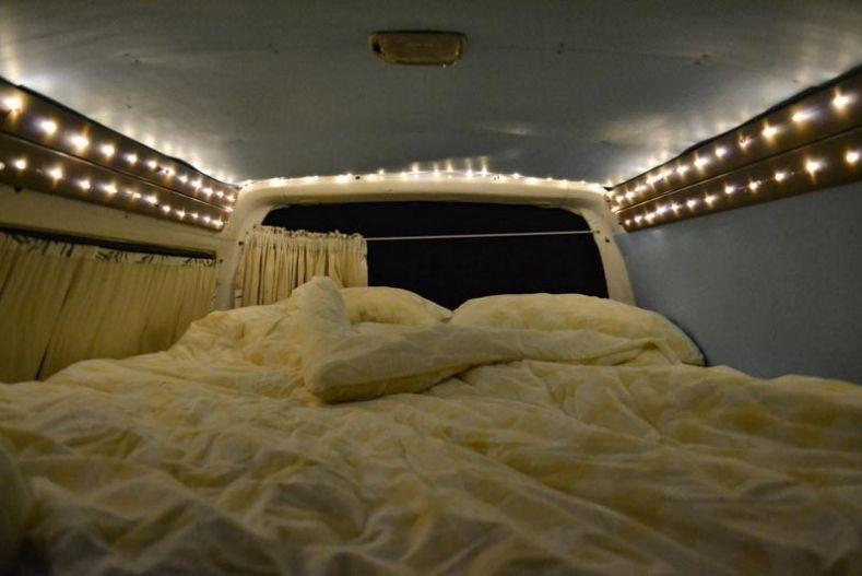 Small string lights installed around perimeter of camper shell interior