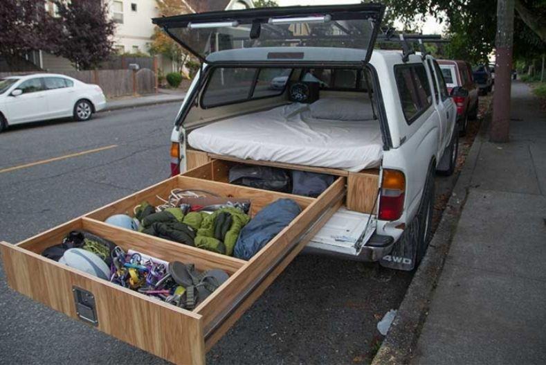 Full truck length drawer slide out with platform bed above