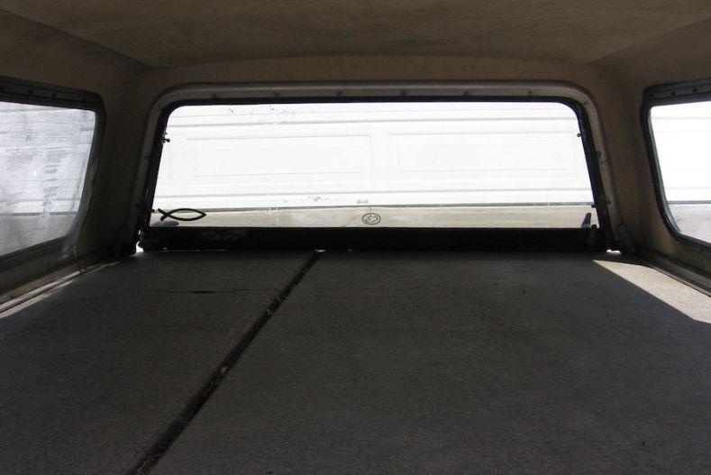 Camper shell interior idea: Platform bed