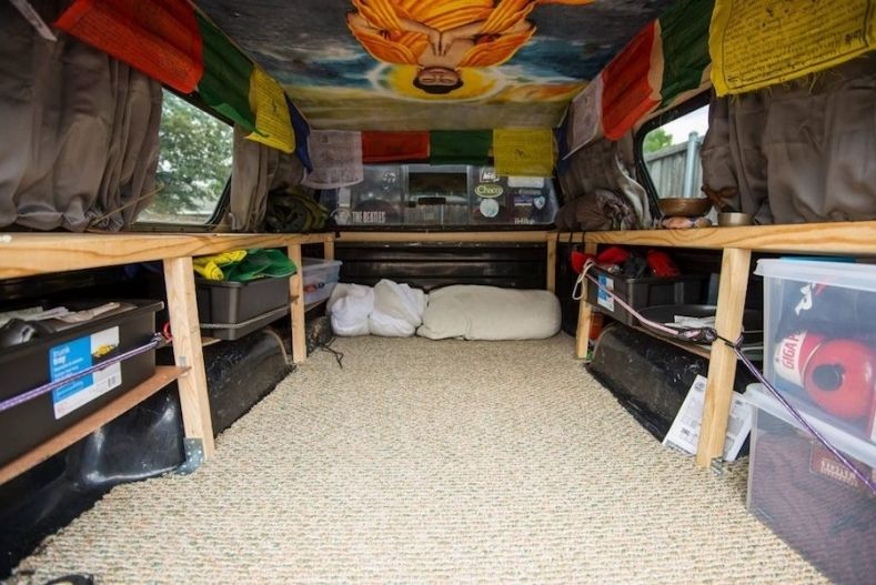 Wrap around shelving with fully stocked shelves in a truck camper