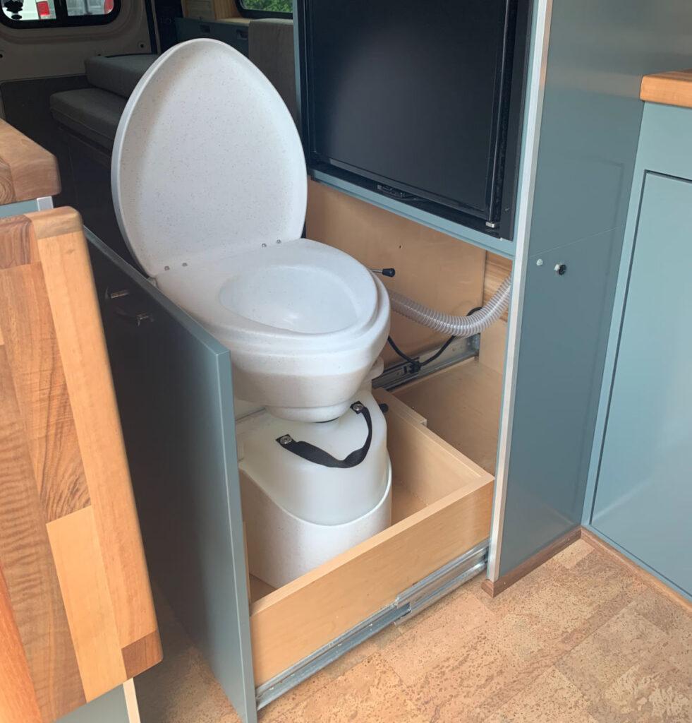 Campervan composting toilet in a cabinet