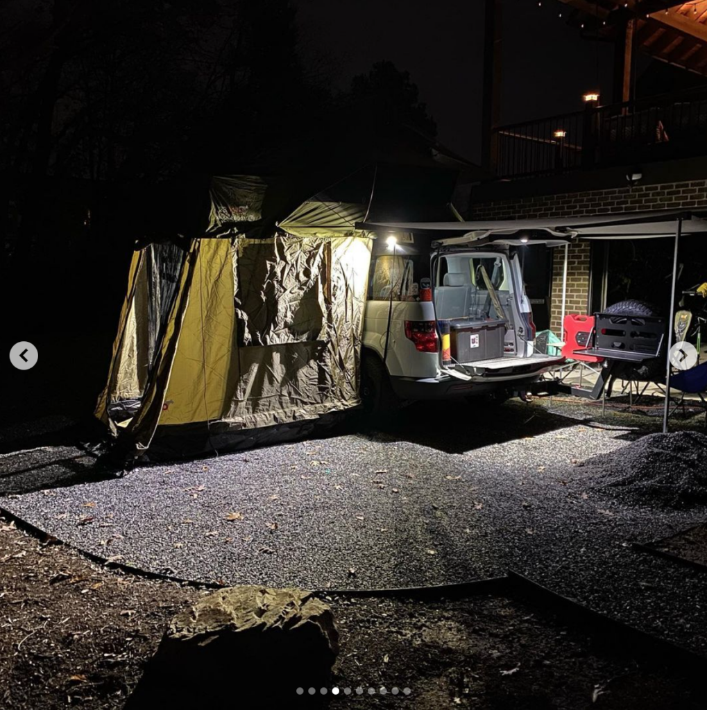 Element camper conversion with an attached tent