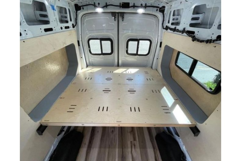 Camper van idea with side extending flares on either side of the van