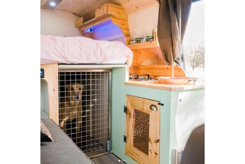 Built in dog kennel inside of a camper van