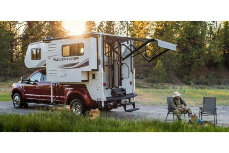 Adventurer camper on red pickup truck