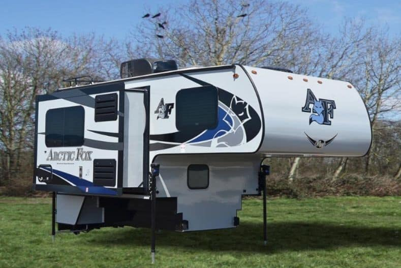 Arctic Fox 1/2 ton truck camper set up on the ground