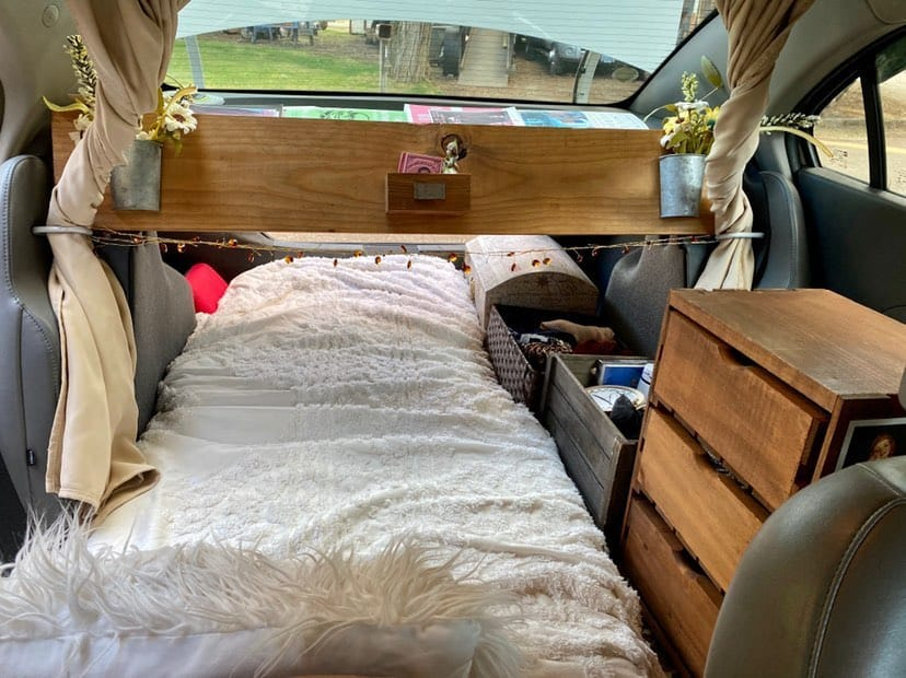 car camper interior with bed and dresser