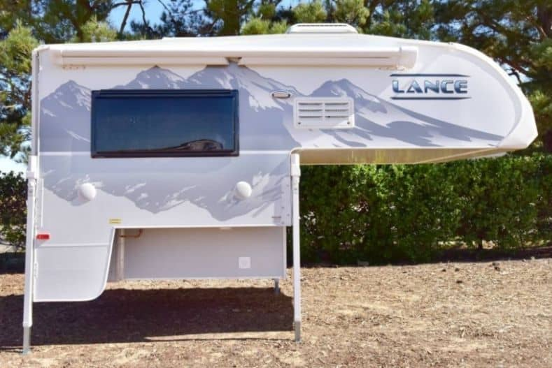 Lance 1/2 ton truck camper on the ground
