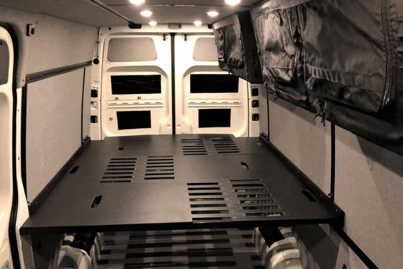 Black MOAB platform bed in cargo van conversion