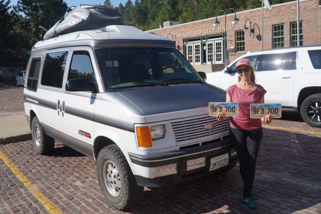 Woman standing in front of a van with South Dakota license plates