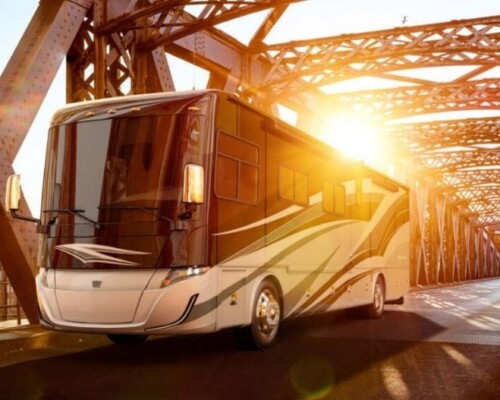 Tiffin Allegra Class A motorhome with bunks driving over bridge